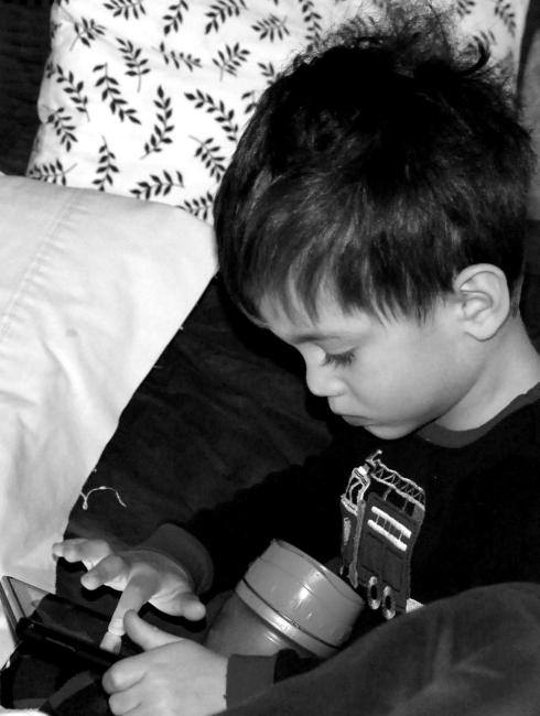 Charlie loves to get in my and Jason's bed and play on the Kindle or watch cartoons in the morning.
