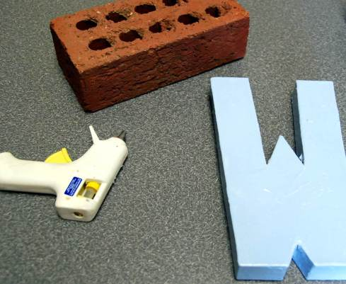 "I painted my ""W"" blue to match our bedroom walls.  I decided to leave the brick its natural color.  You could paint both the letter and the brick white and that would be really pretty."