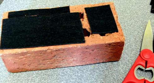Glue some felt onto the bottom of the brick-otherwise it will scratch your furniture.