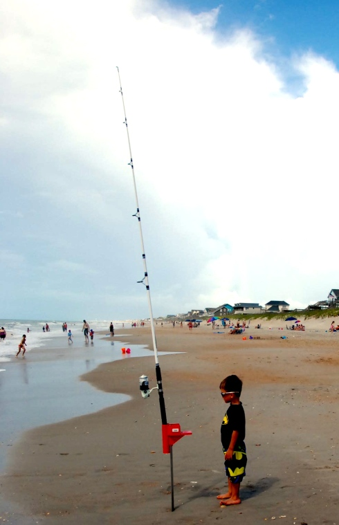 Charlie doing some serious fishing on the beach.