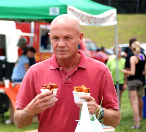 It was also wingfest at the Farmer's Market today-Daddy is very serious about his wings!