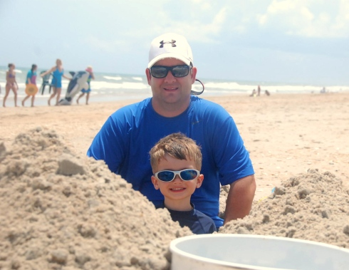 I love this pic of Jason and Charlie sitting in the HUGE hole they dug!