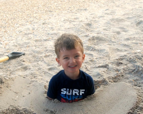 Charlie was so excited when Jason buried him in the sand!