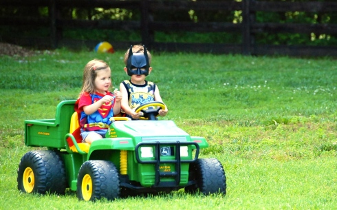Batman and Superman on their favorite form of transportation!  The Batmobile!