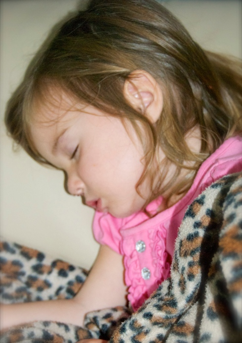 Maddie fell asleep in the chair while she was watching Silly Songs-too precious!