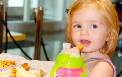 Emma enjoying a grilled cheese for lunch. They had really good sweet potato fries!