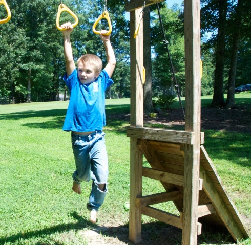 Evan showed Charlie how to use the new swing set!