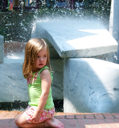 Maddie in front of the fountain.