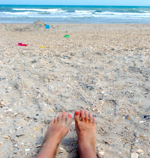 This pic is from our last beach trip-my toes are now neon orange!