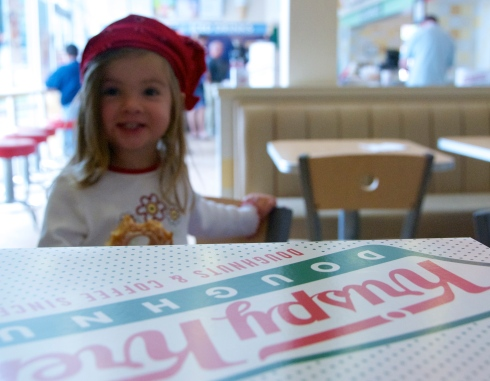 Maddie enjoying a free doughnut. She made the cutest pirate ever.