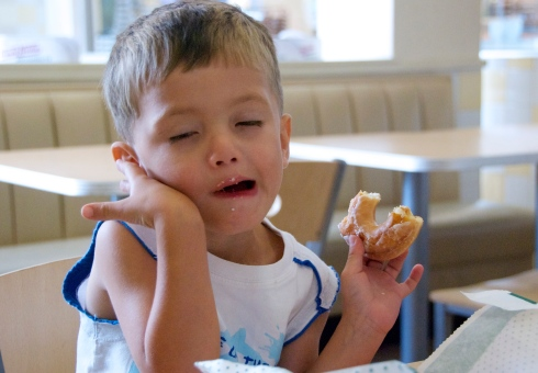 "Charlie was practicing saying ""Aaaaaarrrgghhh!"" It's hard to do with a mouthful of free doughnut!"