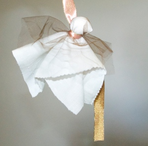 3-Secure it with a piece of ribbon around the ghosts neck.