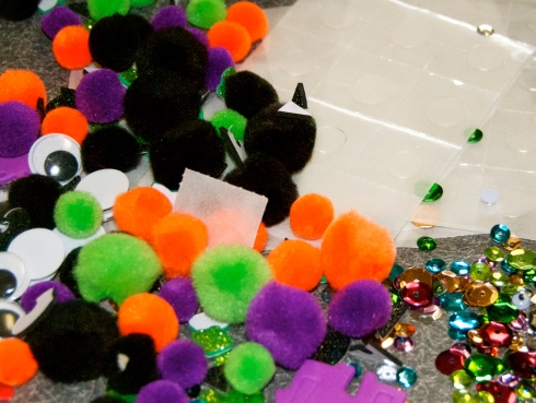 fuzzy balls, sequins, wiggly eyes, and glue dots