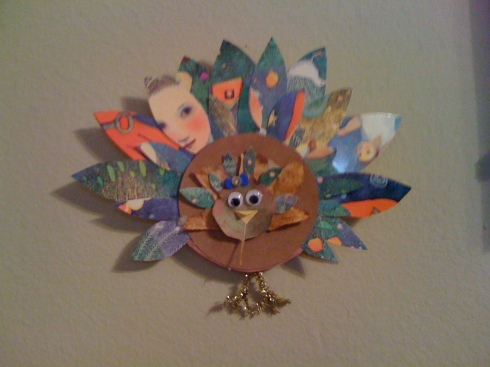 I love this turkey.  The feathers are made out of old greeting cards.  I can't get back to the original source, so if it's yours please let me know so I can give you credit!