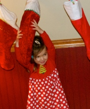 Maddie at Daddy's trying to break into her stocking!