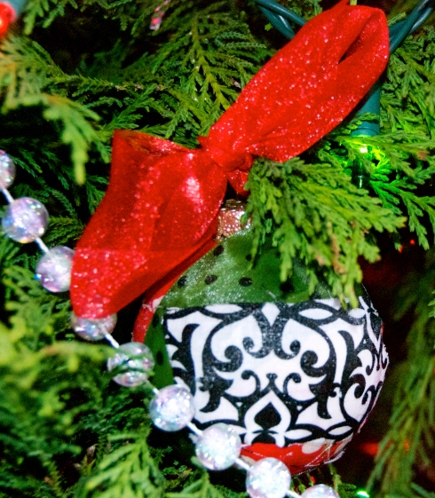 I made a couple of ornaments myself by mod podging strips of fabric to a  glass ball.