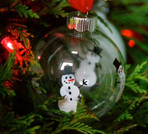 This is one of my favorite ornaments.  The kids dipped their fingers in white paint then made snowmen with their fingertips.  I used paint pens to add the snowman's embellishments, then wrote the kids' names and the year on the bottom of the ornament.  We have made tons of these-what a great gift.  I got this idea from Pinterest, but can't get back to the original source, so if it is your's please let me know so I can give you credit for this awesome idea!