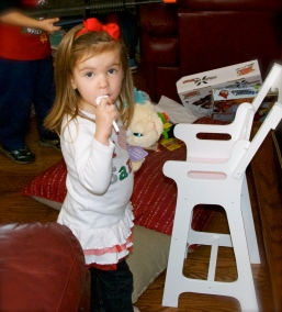Maddie loved her new high chair from Gaga.