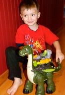 Charlie and his new dragon from Papa. He sleeps with this thing!