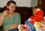 Casey, Mama, and Big Hugs Elmo.