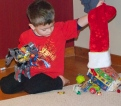Charlie dumping out his stocking at Papa's.