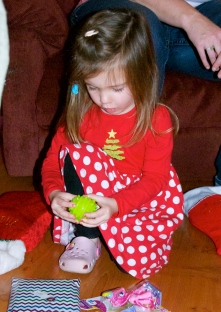 Maddie inspecting the contents of her stocking at Papa's. I love the look on her face here.