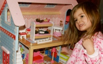 Maddie and her new dollhouse on Christmas morning.
