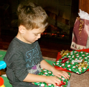 Charlie trying to restrain himself from tearing into a present at Sandra's.