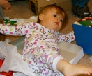 Addison wallowing in the wrapping at Sandra's.