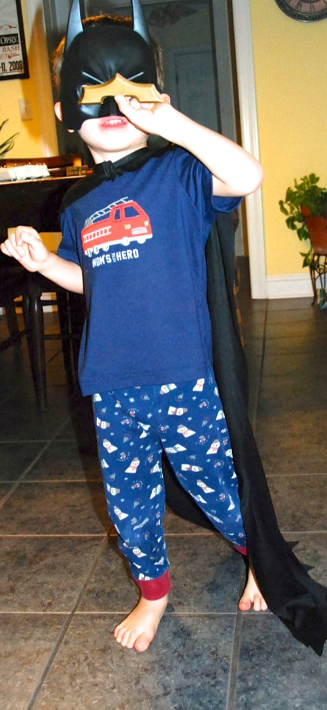 This photo is from March, and these pajamas are now too small for the Chachinator.  His batman costume, however, is not!  He still loves everything Batman, and has added several other costumes to his collection.