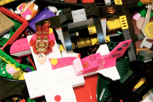 A mixture of Hello Kitty and DC Superhero Legos.