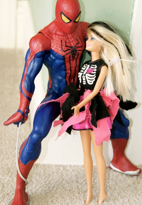 "Maddie loves to take Charlie's superhero figures and make them ""friends"" with her Barbies."