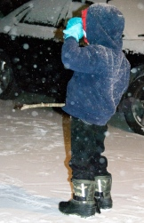 """Charlie with his """"snow stick."""" He loved drawing designs in the snow."""