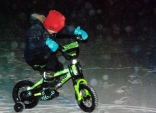 Charlie had to try out his bike in the snow.
