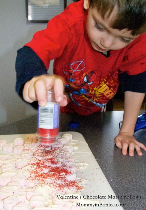 My assistant, Charlie, sprinkled red sugar over the hearts.