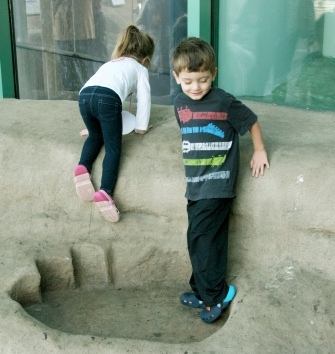 Standing in a dino foot print.