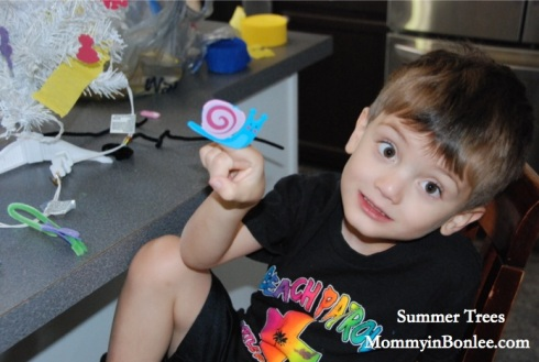 Charlie working on a snail for Maddie's tree.